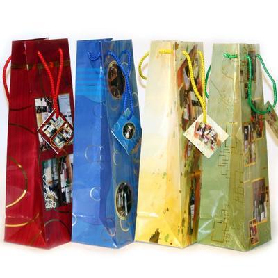 Пакет подарочный ламинированный под бутылку Праздничный (33x10.2x8.9 см)